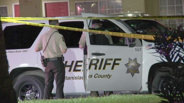 Sheriff's Department at Scene of Carjacking Homicide