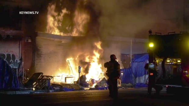 Outdoor Fire Sets Structure Ablaze
