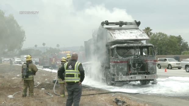 Firefighters Extinguish Trash Truck Fire