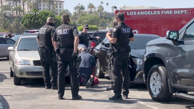 Paramedics Attend to Man Injured in a San Pedro Parking Lot Fight