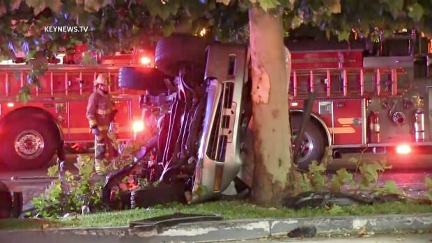 Vehicle on Side After 1 Trapped in Valencia Collision.