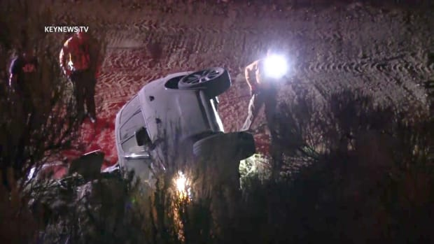 Sheriff's Deputies Examine Vehicle at Bottom of Embankment in Newhall