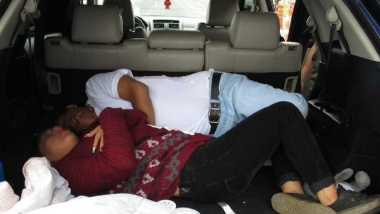 PREGNANT WOMAN SMUGGLED ILLEGAL IMMIGRANTS, WITH 2 OF HER KIDS IN CAR