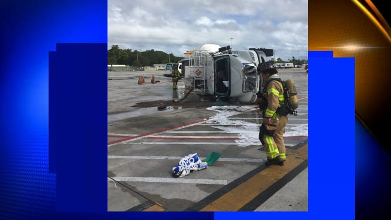 FUEL TRUCK FLIPS OVER AND SPILLS GAS OVER TARMAC AT PALM BEACH AIRPORT