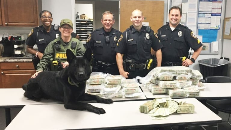 $900,000 CASH CONFISCATED BY POLICE DURING TRAFFIC STOP