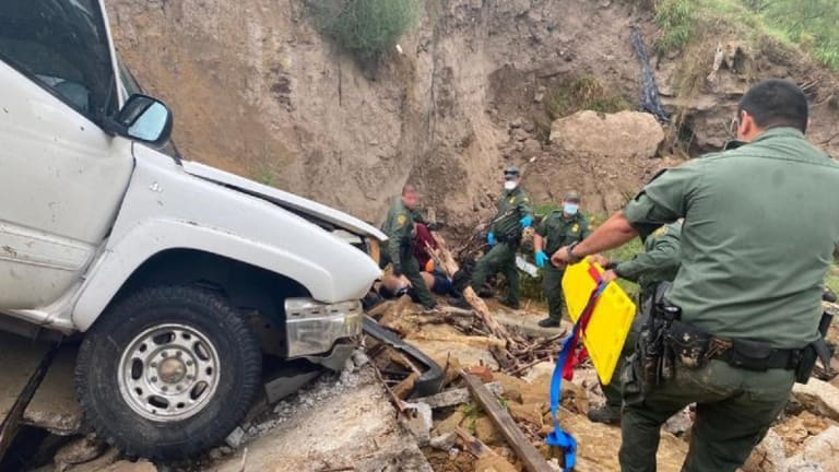 IMMIGRATION SMUGGLING CHASE LEADS TO TRUCK DRIVING OFF CLIFF