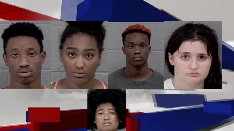 GROUP CHARGED IN 7-ELEVEN ROBBERY, BARRICADED THEMSELVES IN RESIDENCE