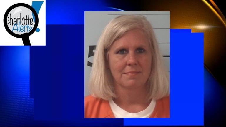 SCHOOL RECEPTIONIST CHARGED WITH TAKING INDECENT LIBERTIES WITH STUDENT