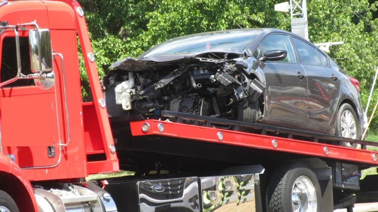 TWO PEOPLE KILLED AFTER COLLISION WITH TWO DUMP TRUCKS