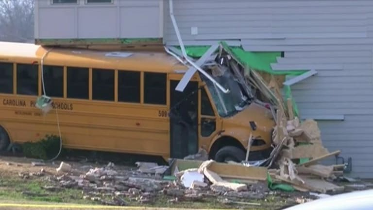SCHOOL BUS RUNS INTO BUILDING WHILE STUDENTS ABOARD, INJURIES INVOLVED