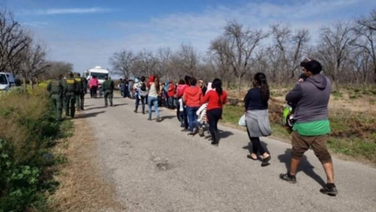 LARGE GROUP OF 242 ILLEGAL IMMIGRANTS SURRENDER IN ARIZONA