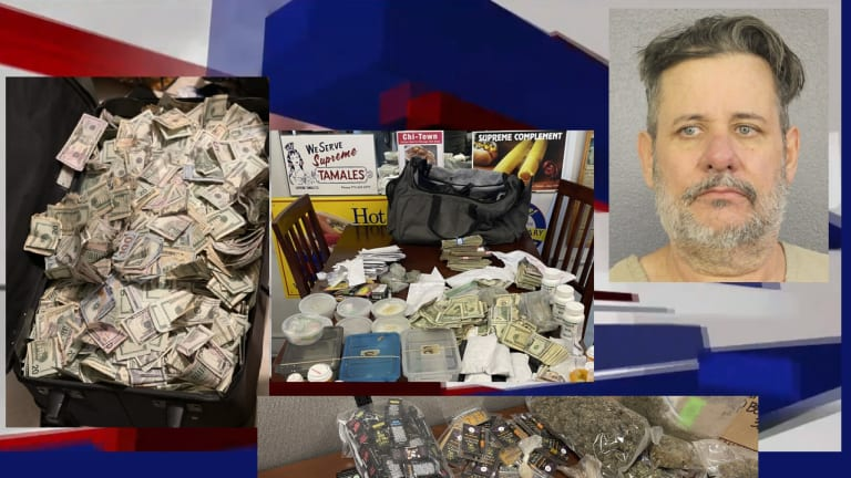 ALLEGED DRUG DEALER HAD $500,000 CASH AND COCAINE IN SUITCASE