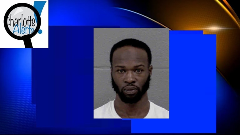 SUSPECT CHARGED IN MURDER OF MAN SITTING IN VEHICLE