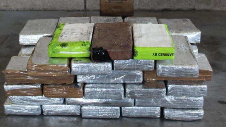 $960,000 IN COCAINE FOUND IN COMMERCIAL SHIPMENT AT CARGO FACILITY