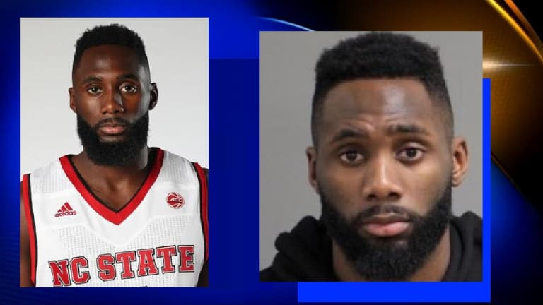 NC STATE BASKETBALL PLAYER ARRESTED, CHARGED WITH HITTING LADY IN FACE
