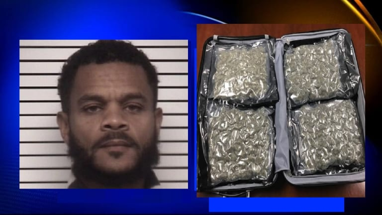 DRUG SUSPECT ARRESTED AFTER 14 POUNDS OF MARIJUANA ALLEGEDLY FOUND IN VEHICLE