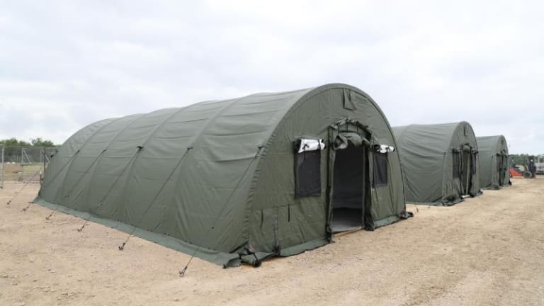 UNITED STATES BORDER PATROL BUILD MOBILE TENTS FOR ILLEGAL IMMIGRANTS AT BORDER