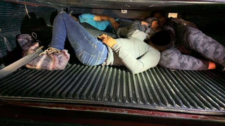 ILLEGAL IMMIGRANTS CROSS INTO UNITED STATES AND HIDE IN BED OF A SPEEDING TRUCK