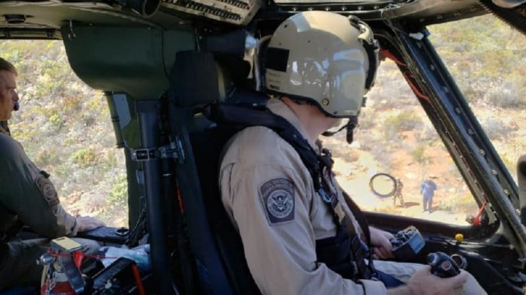 TWO ILLEGAL IMMIGRANTS RESCUED BY HELICOPTER IN MIDDLE OF DESERT