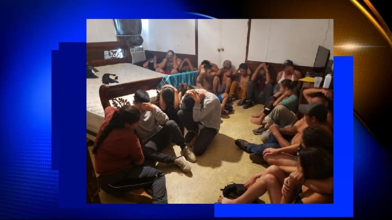 LARGE GROUP OF ILLEGAL IMMIGRANTS FOUND AT STASH HOUSE