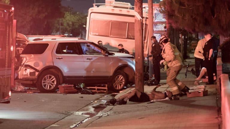 Two Car Collision Traps Pedestrian Under Vehicle