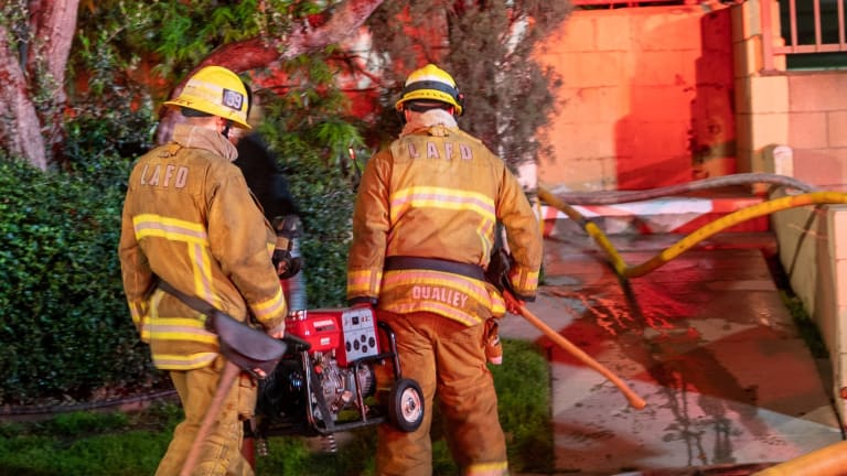 Firefighters Battle Stubborn Fire in Walls of 2-Story Encino Apartment Building