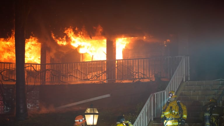 Two Residents and Their Pet Dogs Escape Intense House Fire