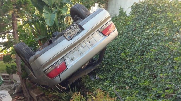 Elderly Man Overturns Sedan Near Side of Home