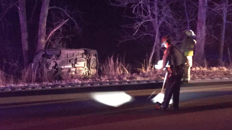 Injured Man Transported by Ambulance After Rollover Crash