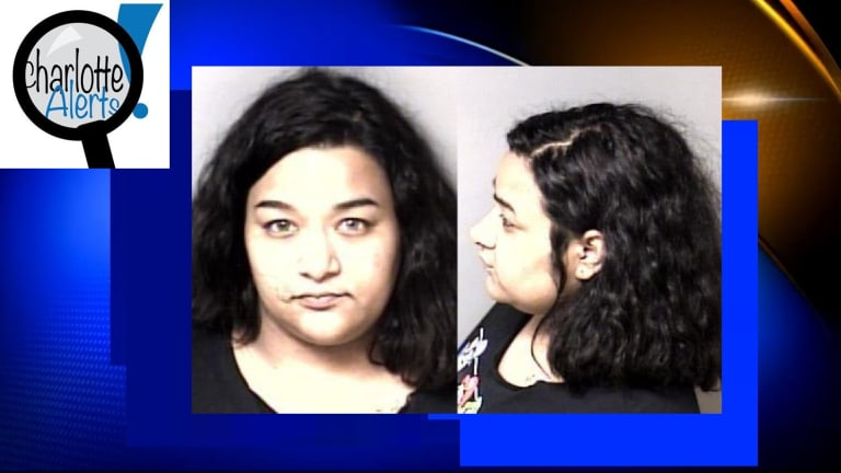 WOMAN CHARGED WITH SHOOTING MAN IN THE HEAD