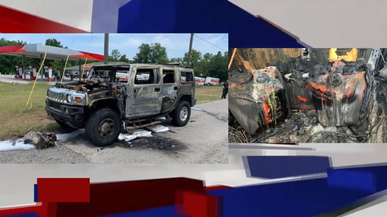 HUMMER BURSTS INTO FLAMES AFTER SEVERAL GAS CANS STUFFED IN TRUNK