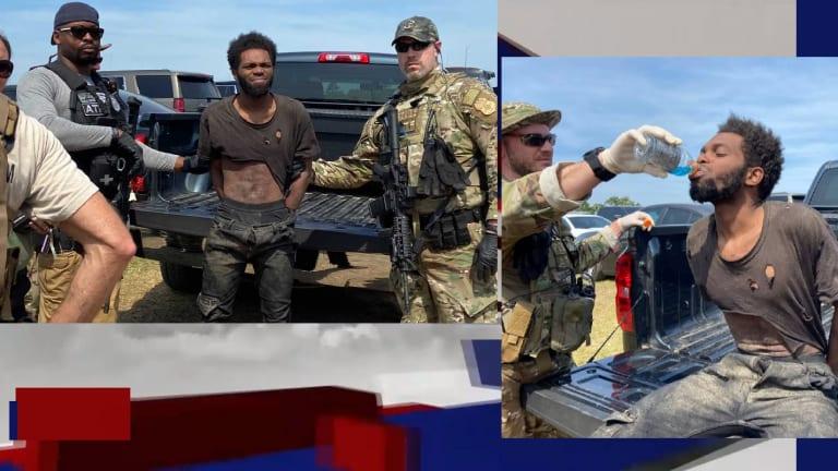 BLACK MALE QUADRUPLE MURDER SUSPECT ARRESTED AFTER LIVING IN WOODS AND GUN BATTLE