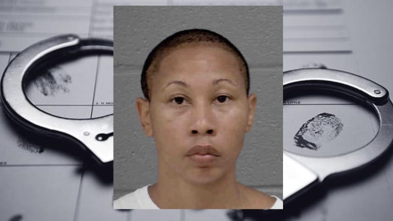 WOMAN CHARGED WITH KILLING BOY IN HIT AND RUN WRECK