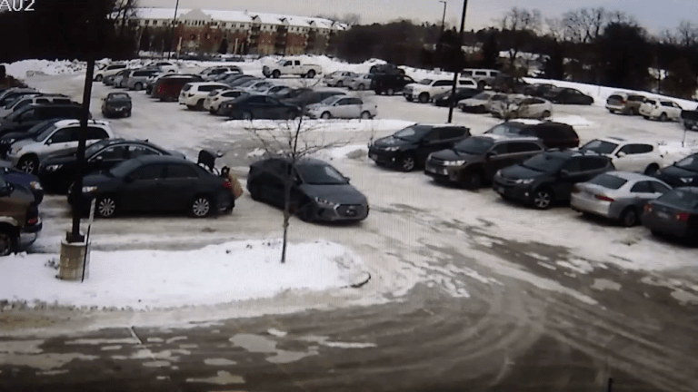 VIDEO: WOMAN ROBBED IN PARKING LOT AND THEN DRAGGED BY FLEEING SUSPECT VEHICLE