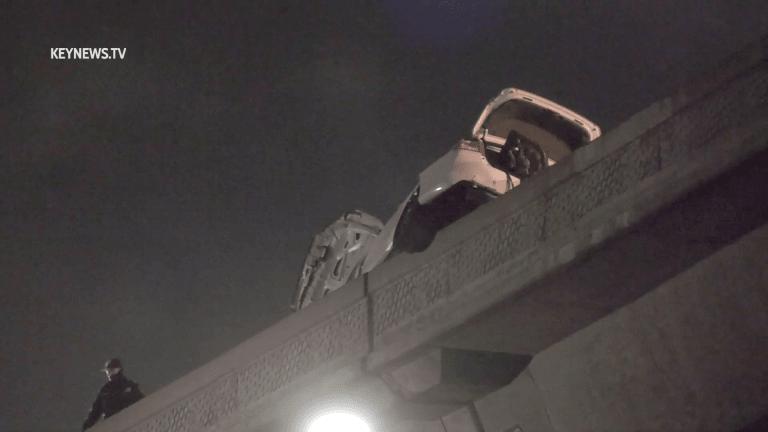 2-Vehicle Crash, 1 Hanging over 110 Expressway Bridge