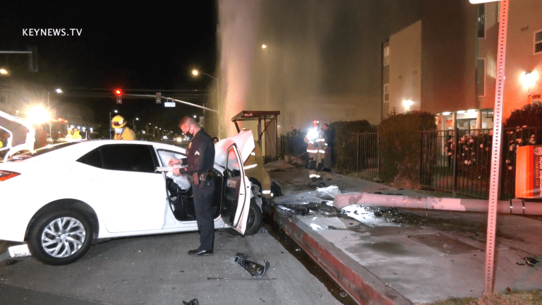 Vehicle Collision Involves Downed Light Pole, Gushing Hydrant