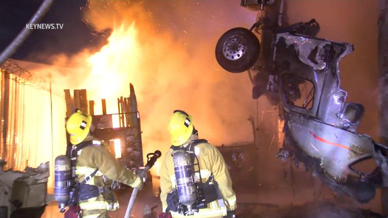 Fiery Big Rig Hangs off I-10 Freeway After Rolling in DTLA
