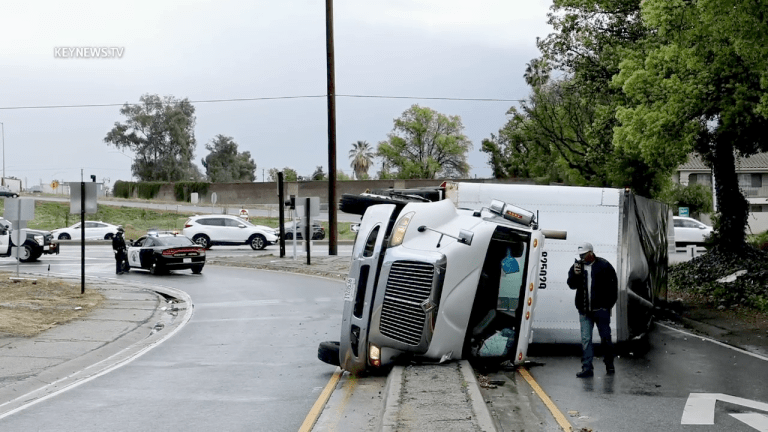 Driver Extricates Himself from Overturned Semi Tractor Trailer in Burbank