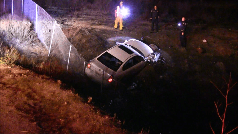 Vehicle Exiting 14 Freeway Lands over Fence