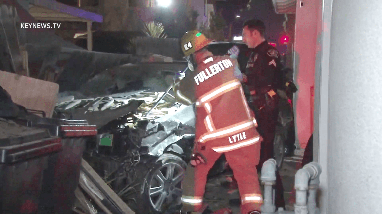 Pursued Vehicle Drove Through Yards Before Crashing into Structure
