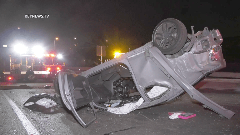 Vehicle Rollover Traps 2 People off 10 Freeway