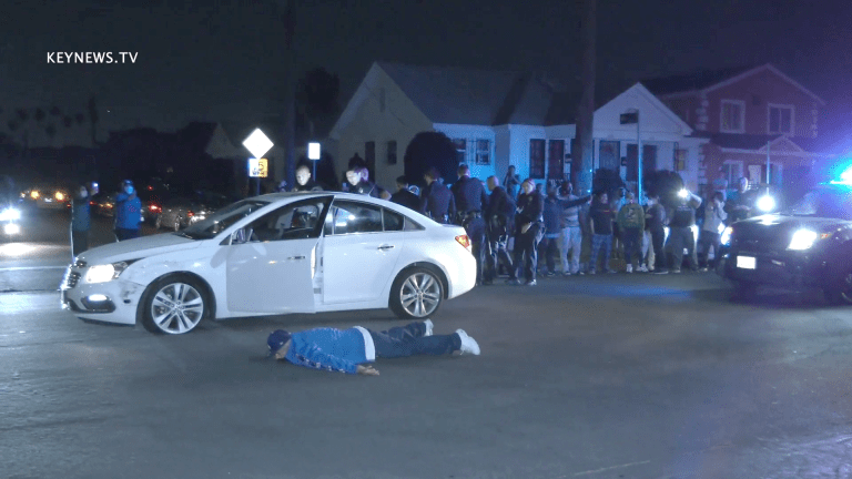 Large Group Crowds End of Police Pursuit