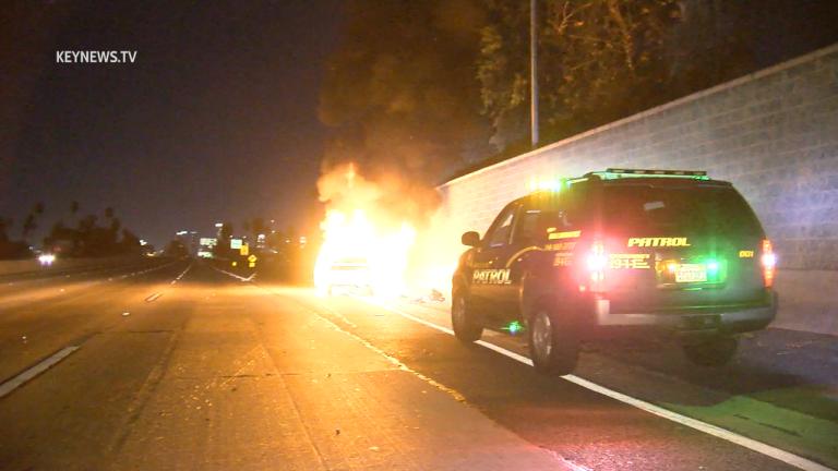 Injured Victim in Fiery Freeway Crash Found with Gun