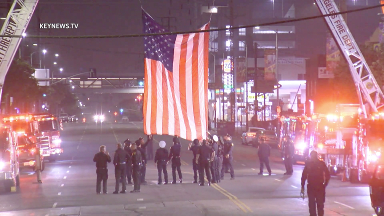 Vehicle Procession Escorts Slain Firefighter to Coroners Office in Boyle Heights