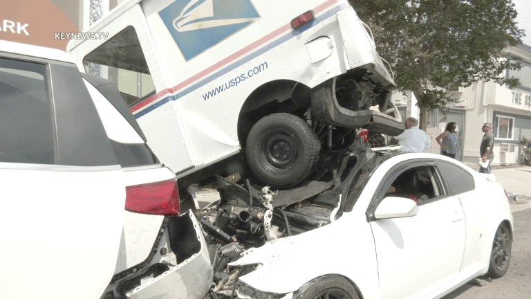 United States Postal Service Truck Crashes, Lands on Parked Vehicles in Valley Village