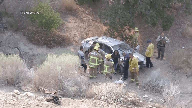 Vehicle Plunges 50 Feet Down Embankment Injuring 2 People