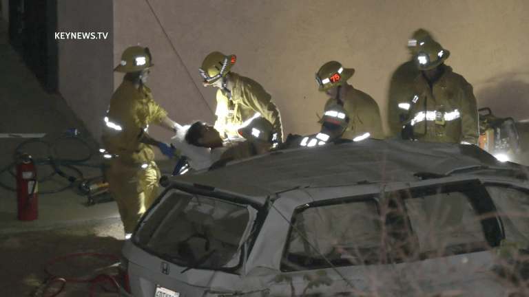 2 Trapped After Minivan Lands into Residential Backyard off 118 Freeway