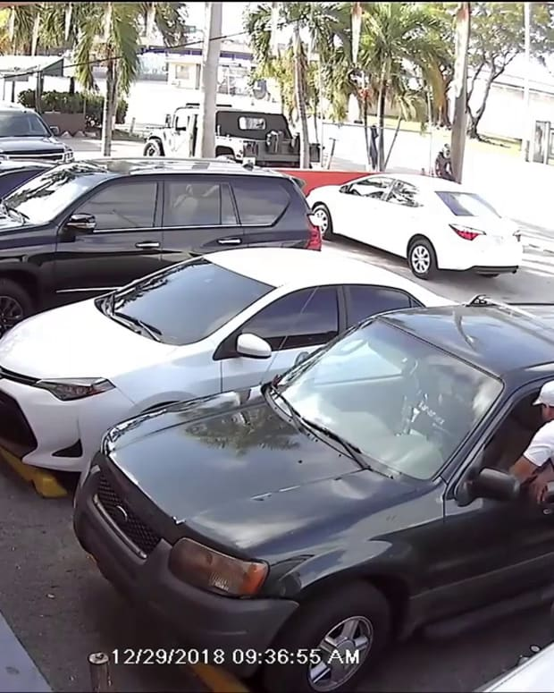 Video_shows_man_who_cops_say_posed_as_officer_to_steal_SUV_M_Trim