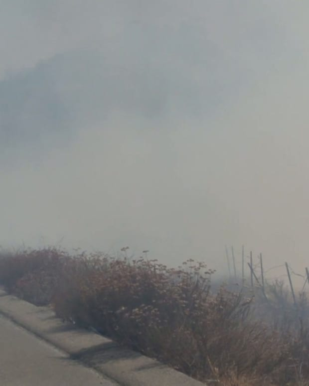 Vegetation Fire on I-215 Causes Southbound Traffic Delays