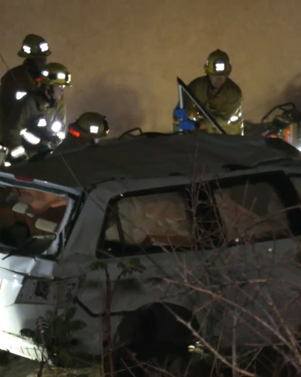 2 Trapped After Landing into Backyard off 118 Freeway